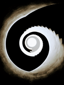 A high contrast image of black and white spirals that emerge as a spiral staircase leading downward.